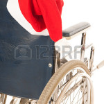 24460883-wheel-chair-with-red-hat-santa-claus-isolated-over-white-background